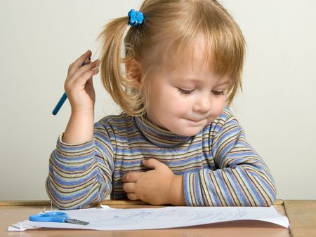 young pretty girl teach draw with blue pen Stock Photo - 562937