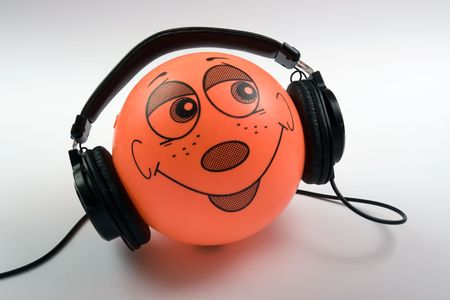 headphones on ball with face on it