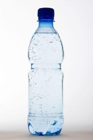 half full: bottle of water on white background Stock Photo