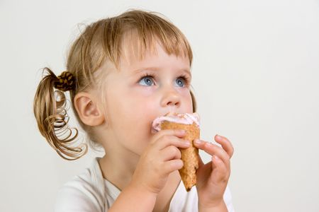 young girl eating tasty ice cream Stock Photo
