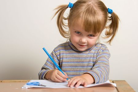 young pretty girl learn drawing with blue pen Stock Photo - 611228