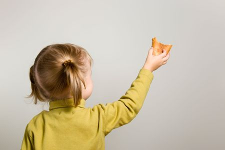 takings: young girl share with bread Stock Photo