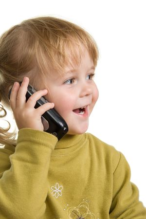 child in green talking by mobile phone Stock Photo - 611222