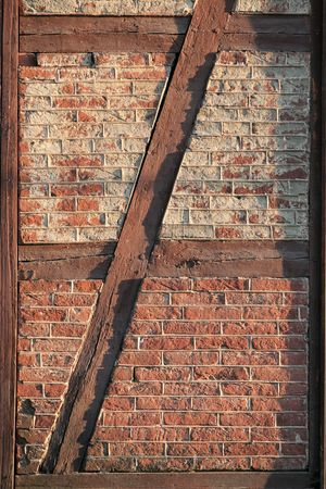 exasperate: old brick wall framed in painted wood