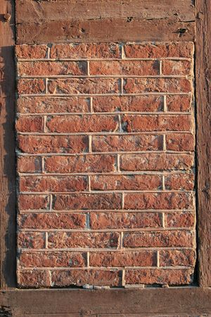 exasperate: fragment of framed old brick wall Stock Photo
