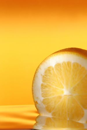 sheeny: orange in water on yellow background rotated at 180 degrees