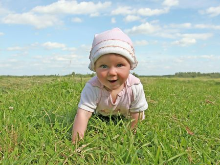 happy baby in summer meadow