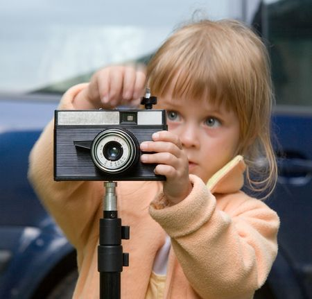 young cute girl at her camera Stock Photo - 1952343