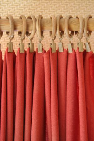 pucker: red curtain at holder rings Stock Photo
