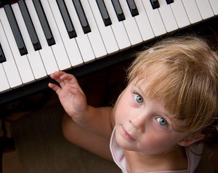 nice girl at digital piano photo