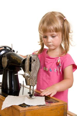 stitchcraft: nice girl at old sewing machine