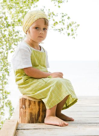 little girl sitting at beam