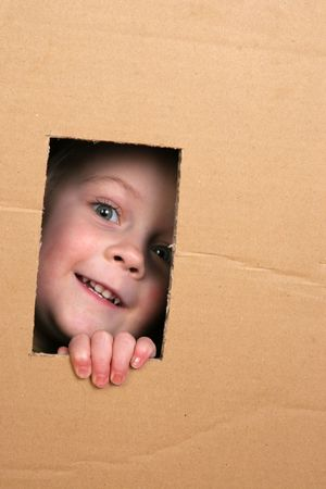 dorm: young girl looking from brown carton box