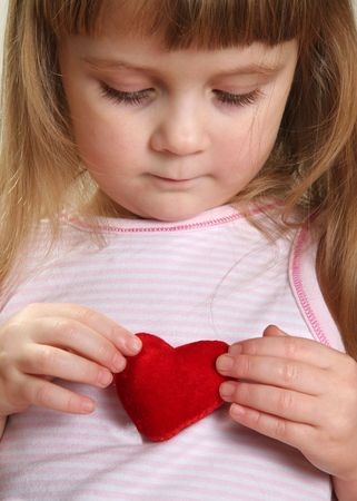 pretty child with red heart