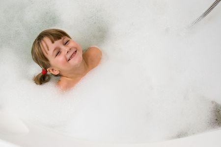 young girl in foam bath