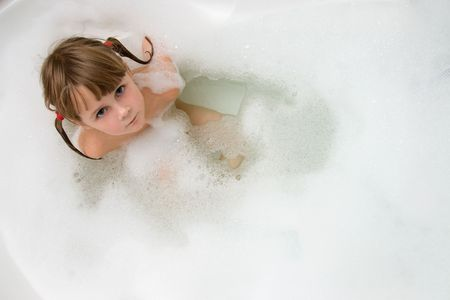 young girl in foam bath photo