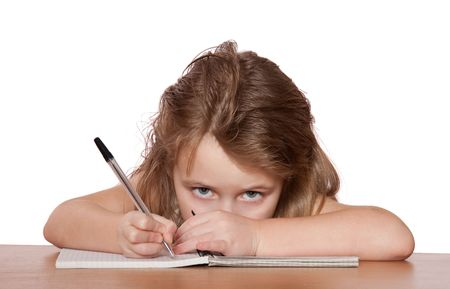 Young girl writing at her