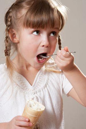 Nice girl eating ice cream