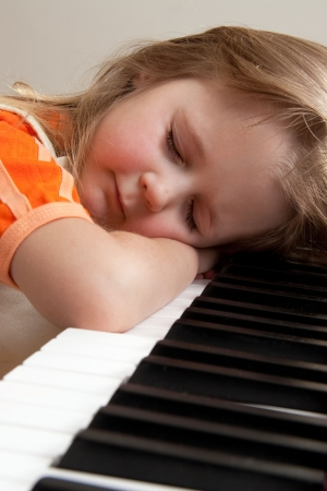 Nice girl learn playing piano Stock Photo