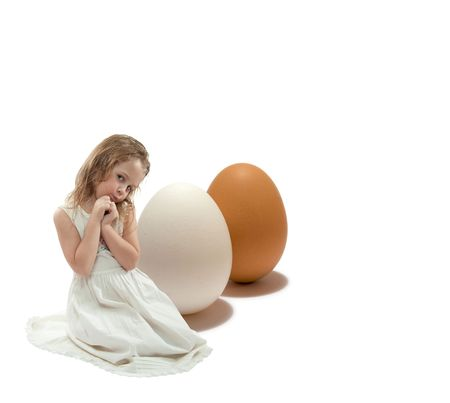 nice girl and two eggs in different colors, isolated