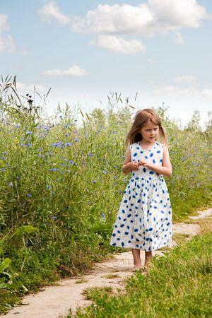 Young girl at rural road