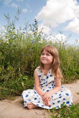 Young girl at rural road photo
