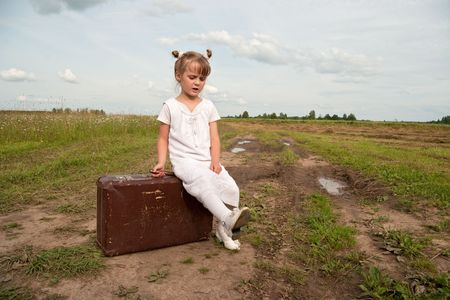 friendless: Young girl on rural  road