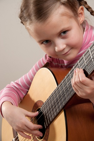 Young girl play classical guitar Stock Photo