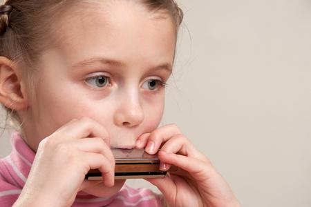 harmonica: Young girl play blues harmonica Stock Photo