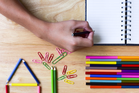 Back to school. Colorful Office and study art stationery objects on wood table with open notebook.Kid love to drowing.
