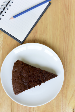 short crust pastry: After lunch .chocolate cake on wood table. good for write story. Stock Photo