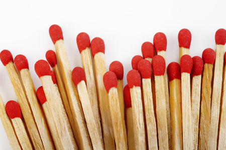 matchstick: Red matchstick on white background