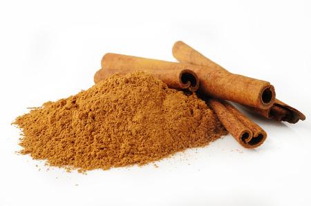 wood stick: cinnamon powder on white background