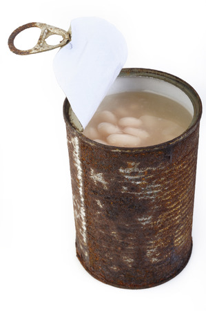 rot: white beans rot in rust cans Stock Photo