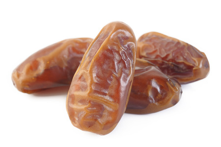 dry fruit: Dried dates isolated on white background