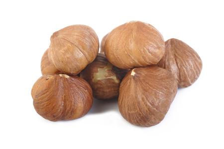 peeled: peeled hazelnuts isolated on white background