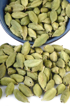 asian flavors: green cardamom pods in bowl