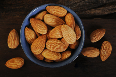 almond nuts in bowl Imagens