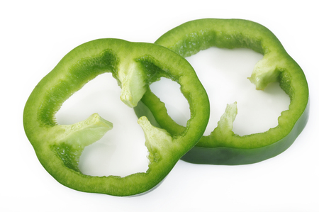 Sliced green pepper isolated on white background
