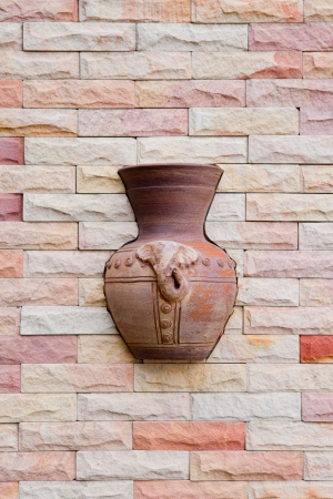 This is a vase in the wall of a resort  in Rayong, Thailand photo