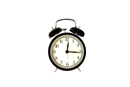 twin bell alarm clock on white background photo