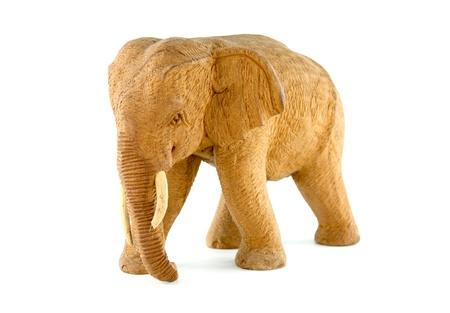 wooden elephant on white background photo