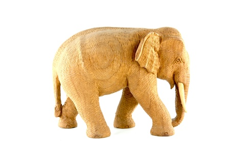 wooden elephant on white background photo