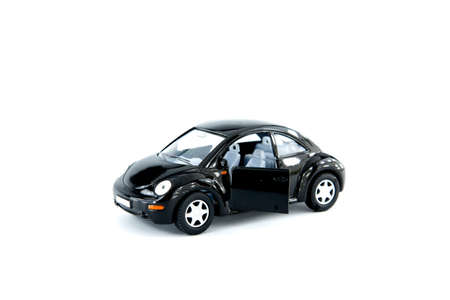 Black toy car  on a white background photo