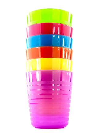 Three color plastic cup on a white background photo