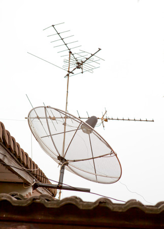 Satellite dish and antenna. photo