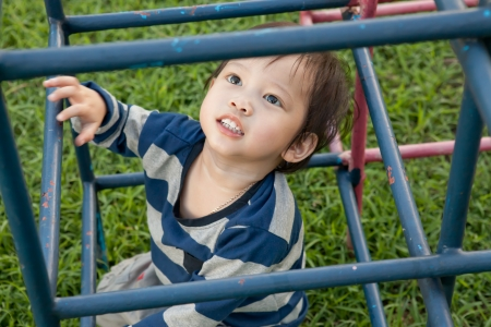 A happy little boy on a playground. photo