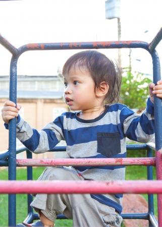 obesity kids: A happy little boy on a playground.