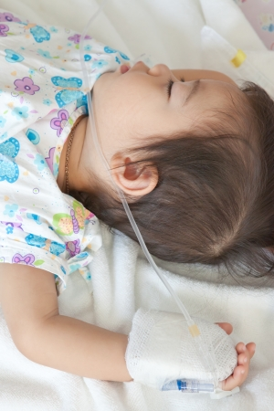 little boy patient sleeping in hospital photo