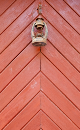 scintillating: Antique oil lamp on orange background